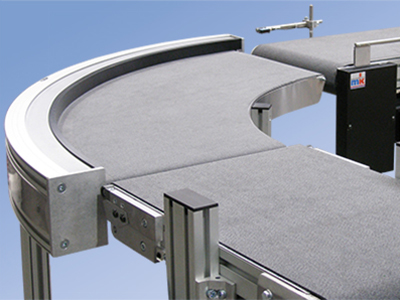 Belt conveyors from mk North America allow for conveying parts around corners.